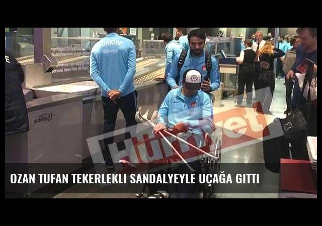 Ozan Tufan tekerlekli sandalyeyle uçağa gitti
