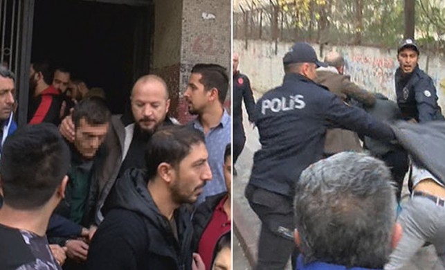 Sultangazi'de yangın sırasında yan binaya girerek telefon çaldığı iddia edilen bir kişi, linç edilmek istendi