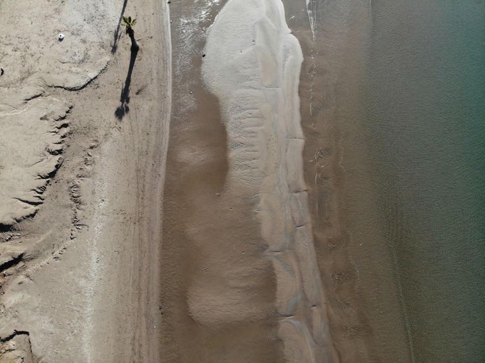 Muğla'da şaşırtan görüntü! Deniz 20 metre çekildi
